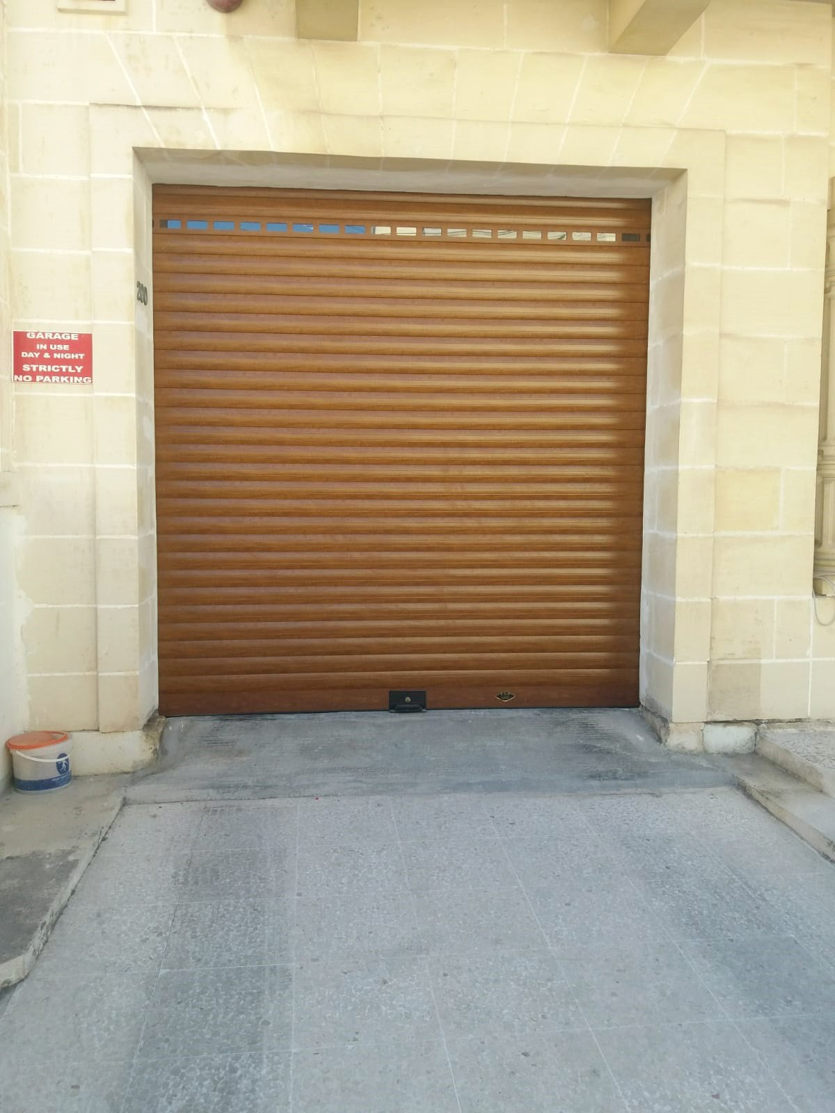 Roller Shutter Insulated Aluminium Walnut complete with matching windowed slat.