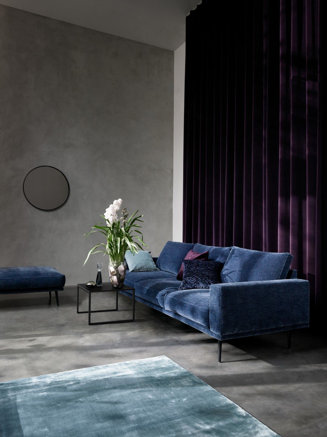 The Carlton sofa in blue velvet is a timeless piece